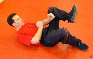 Wing Tsun Exercise 72, Fig. 1 - Sifu bends his leg, the other is resting on the ground