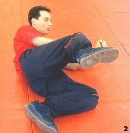Wing Tsun Exercise 73, Fig. 2 - In this position he turns his body to left