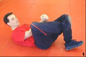 Wing Tsun Exercise 73, Fig. 1 - Sifu Dragos bends his leg