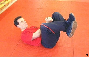 Wing Tsun Exercise 80, Fig. 1 - Sifu crosses his legs