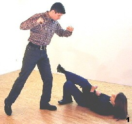 Wing Tsun Exercise 88, Fig. 1 - Melanie is beeing kicked form the side.