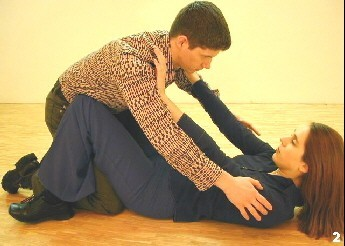 Wing Tsun Exercise 94, Fig. 2 - Melanie pushes the attacker back from inside positioon