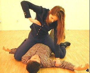 Wing Tsun Exercise 97, Fig 4 - She puts herself on top and controlls the upper limbs of the opponent