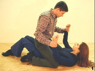 Wing Tsun Exercise 99, Fig 1 - The opponent is sitting on top